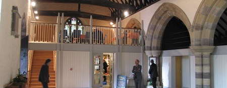 Interior of a church in Yarpole where a gallery and shop have been added and the space made more flexible.