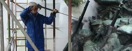 Image showing the cleaning of bronze statuary on a a war memorial with super-heated water.