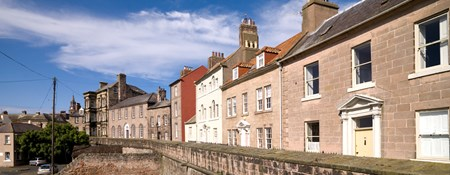 View of houses along quay walls in Berwick-upon-Tweed.