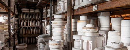 Pottery stacked up on wooden shelves