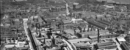 Black and white aerial photo of stoke on trent with lots of cone shaped kiln chimneys