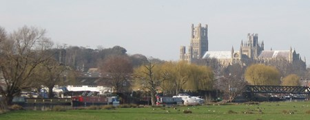 Ely Cathedral and surrounding town photographed across fields