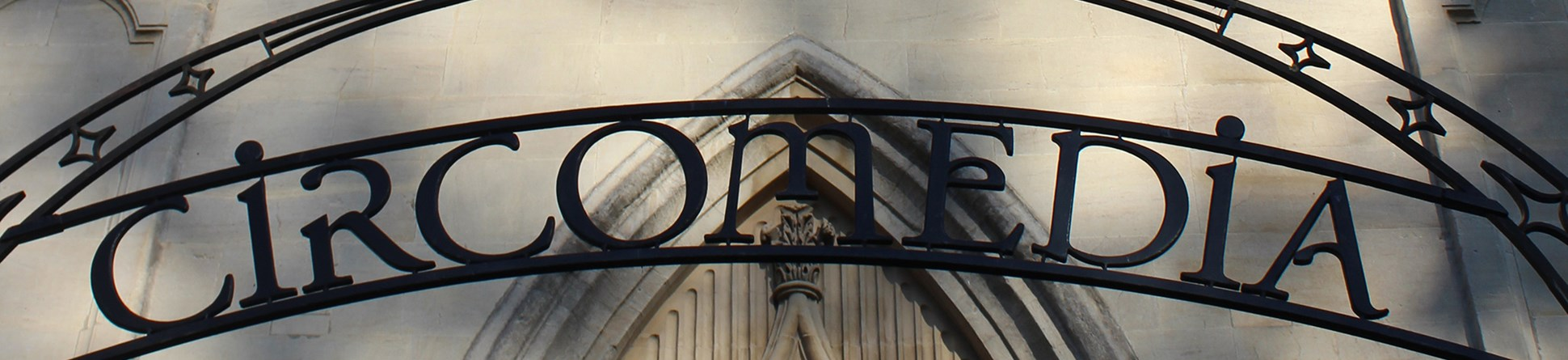 Circomedia sign in wrought iron in front of St Paul's church.