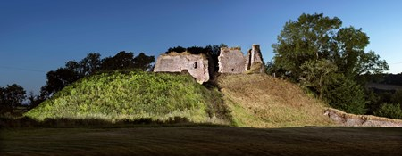 Clifford Castle, Clifford, Hay-On-Wye, Herefordshire. General view of motte and keep, lit at twilight, view from east.